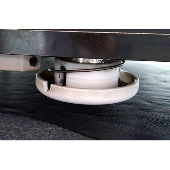 Track blade mushroom-shaped on Teflon